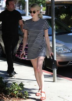 Leggy lady: Emma Roberts paraded her alabaster pins in a navy-striped T-shirt…