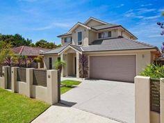 Concrete modern house exterior with brick fence & landscaped garden - House Facade photo 515357
