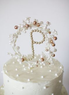 Make a statement with a classic and elegant pearl monogram.