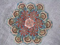 Quiltsmith Australia: Fussy cut hexagons with Suzy Miller.  More examples on this post.