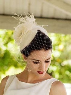 Ivory White. Birdcage Veil, Feather Fascinator, Bridal Veil, Birdcage Veil, Silk Rose, Hat, High Fashion, Weddings, Batcakes Couture. $164.95, via Etsy.