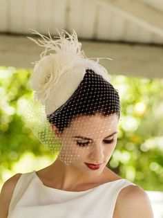 Ivory White. Birdcage Veil, Feather Fascinator, Bridal Veil, Birdcage Veil, Silk Rose, Hat, High Fashion, Weddings, Batcakes Couture. $164.95, via Etsy.