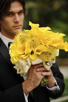 Yellow calla lilies and pincushion protea wrapped in cream ribbon...love it!!
