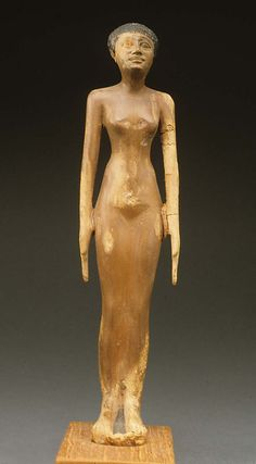 Figure of a woman-  Period: Old Kingdom Dynasty: Dynasty 8 Date: ca. 2150–2100 B.C. Geography: Country of Origin Egypt Medium: Wood, paint