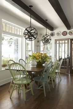 Love the floors, the painted chairs, the light fixtures, etc., etc.,....