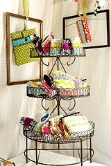 nice 3 tier display with open frames in the back with products hanging in the middle...neat!