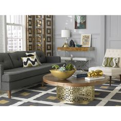 okay, i love the gold cocktail table. but my couch is pale gray. i feel i cannot make this work. @Nicole Zaks, thoughts?