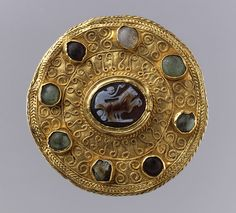 Roman-Langobardic Disk Brooch with Cameo and Cabochons. The Roman Cameo dates from c. 100 - 300 AD, and the Langobardic brooch from c. 600