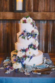 Colorful floral topped wedding cake: http://www.stylemepretty.com/little-black-book-blog/2016/05/25/sweet-diy-details-rustic-barn-wedding/ | Photography: Alexandra Meseke - http://alexandrameseke.com/