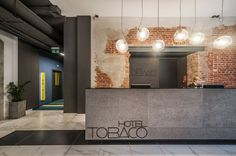 """Tobaco Hotel is a hip hotel located in Łódź, Poland. It was completed by EC-5 in 2013.                     Tobaco Hotel by EC-5: """"The Tobaco Hotel is located in the centre of Łódź, among historic tenement houses and old factory buildings. The hotel is part of the historic factory building complex. Since 1895, Karol Kretschmer had operated a wool textile factory there. In 1932, the National Cigarette Factory opened on the former textile factory premises. Nowadays, the whole building complex…"""