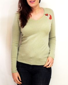 This light green v-neck #cashmere sweater is perfect for a chic layered outfit.