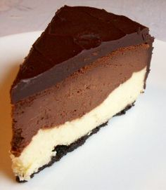 World Class Chocolate Cheesecake (white chocolate, dark chocolate layers) *To make it extra good, remove filling from oreos, crush the cookies into crumbs & use in place of graham cracker crumbs