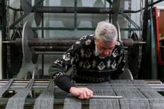 Some of our weavers have been with us for over five decades, and still remember when everything was woven by hand. Now, we use a combination of power looms and hand looms to create our Donegal tweeds.