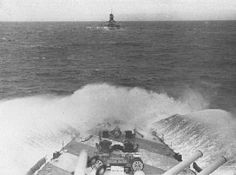 Le navi da battaglia Giulio Cesare (da bordo della quale è scattata questa foto)   e Vittorio Veneto in navigazione in linea di fila con mare agitato