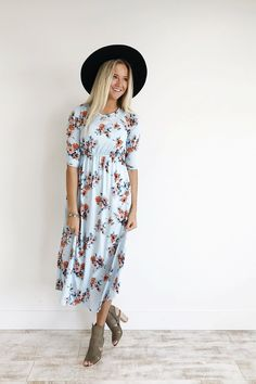 Sky Blue Maxi Dress  Carnation + Sky Blue Floral Bouquet Print  3/4 Sleeve  Gathered Waist + Hip Pockets  Flowing Fit  Also Available in Ivory + Light Pink