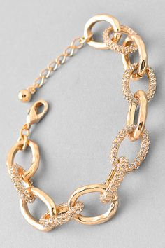 First & Chic   Stay Strong - Gold Chain Bracelet - A gorgeous chain link bracelet in gold tone featuring rhinestones in every other link. Wear either casually or formally, by itself or pair with other bracelets or watch for a layered look.