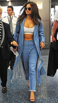 Selena Gomez pretty much owning airport style in a denim on denim look.