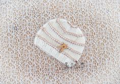 Check out this item in my Etsy shop https://www.etsy.com/listing/175994570/baby-boy-star-button-beanie-knit-baby