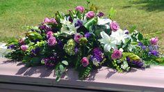 unique funeral flowers   Flowers designed by Unique Floral Designs }
