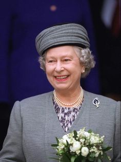 The Queen visiting the St George school in Windsor, on 23rd April 1997 wearing her Art-Deco Leaf brooch. Originally a gift in 1928, from the Queens father (then Duke of York) to his wife the Duchess (later the Queen Mother), then she gave the brooch to the Queen (then Princess Elizabeth) for her birthday during the war.