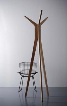 Sexy coat rack!  Made in Italy, the Hi coat stand is a contemporary tripod coat rack. Designed by Pascal Tarabay.