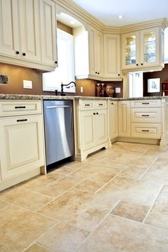 ideas for covering tile floors cream cabinetscream colored kitchen