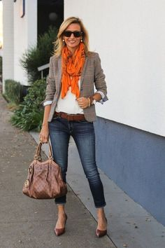 Gorgeous casual or business casual blazer outfit for fall with a great orange scarf and simple brown flats.