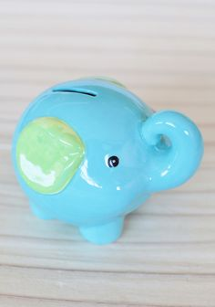 """Little Elephant Piggy Bank 19.99 at shopruche.com. Teach your little one to save from the start with this darling turquoise and lime elephant piggy band. This ceramic piggy bank looks adorable on your child's nightstand or dresser.Imported, 4.5"""" height, 6"""" width"""