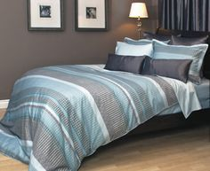 Detailed, intricate elements in horizontal bands of shades of aqua blue, grey and brown, give Graphica its modern contemporary appeal.