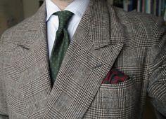 Grey glen plaid jacket with peak lapels, white shirt with grey dress stripes, green tie