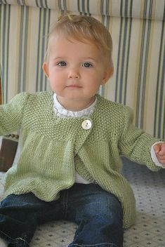 Cute sweater...free on ravelry (original shows it with collar and more buttons). argh! i must learn to knit asap! before baby girl gets to old where she won't want to wear anything mama makes (like her big sis! lol!). this is adorable!