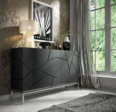 Everly Quinn This beautiful sideboard has a wonderful black color. The sideboard features four cabinet doors that when opened reveal large storage space. Cabinet Furniture, Unique Furniture, Dining Room Furniture, Furniture Design, White Sideboard, Modern Sideboard, Luxury Dining Room, Furniture Catalog, Furniture Stores