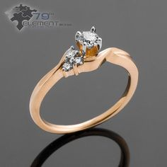 Engagement ring with three diamonds it's very pretty. Look as in 79diamenty.pl