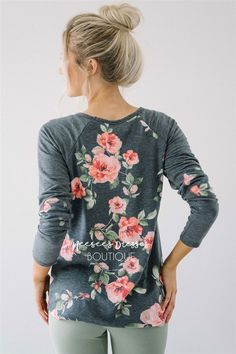 Comfortable, perfect for fall and so so soft! Adorable soft charcoal top features a floral print, solid gray sleeves with floral elbow patches.