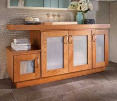 Fieldstone Cabinetry Milan door style in Cherry finished in Butterscotch.