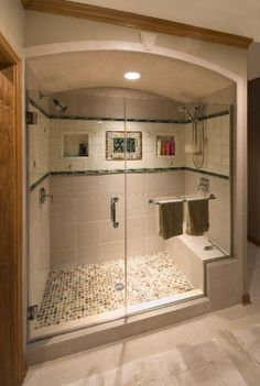 This spacious shower is a mix of very economical porcelain tile and custom hand glazed deco tiles by Pratt & Larson.