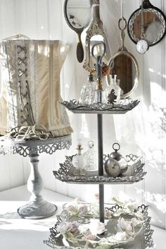Shabby Chic cake stand..different take on china plates....hmmm...maybe could try making a version like this