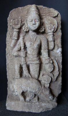 Stone sculpture of the female deity Durga slaying a spirit emerging from the water buffalo Manisha.
