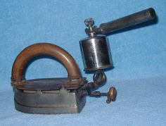 """Self Heating Flat Iron made by the Imperial Brass Mfg. Co., Chicago, IL.; manufactured after 1911; the """"external pump"""" can be left threaded on to the top of the tank"""