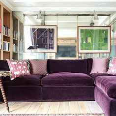 Love the purple velvet couch!  See all our stylish living room design ideas on HOUSE by House & Garden, including this television room in a London flat designed by Adam Bray, which features a purple mohair velvet sofa.