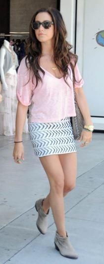 Who made Ashley Tisdale's chain handbag, pink lace top, gold watch, sunglasses, brown boots, gold jewelry, and bandage skirt that she wore in Beverly Hills on June 30, 2011? Skirt -Pleasure Doing Business  Purse – Chanel  Sunglasses – Oliver Peoples  Watch – Michael Kors  Shoes – Joie  Shirt – Blue Life  Necklace – Natalie B