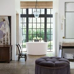 bathroom with an ottoman. Cool!