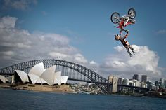 Josh Sheehan of Australia performing the opening jump in the Botanical Garden of Sydney in front of the Harbour Bridge and the Opera House to announce the final stage of the Red Bull X-Fighters World Tour on Cockatoo Island.
