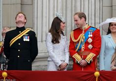 Prince William and Kate share a moment as Prince Harry takes in the atmosphere during the Queen's official birthday celebrations