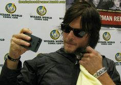 Norman Reedus taking a selfie with a kitten