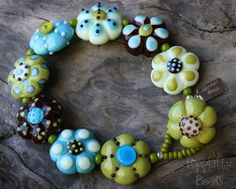 Lampwork Bracelet with Daisy Shaped Beads by hippkittybeads,