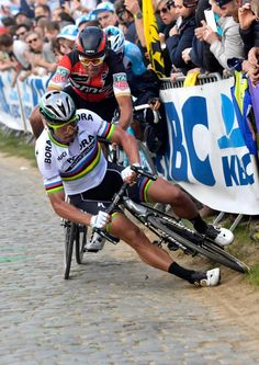Peter Sagan, Greg Van Avermaet and Oliver Naesen hit the deck during Tour of Flanders
