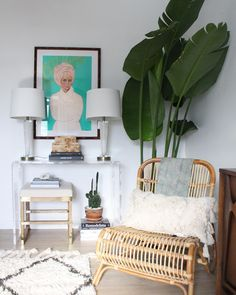 An acrylic console never hurt anyone! Pair it with plants and some focus art for a perfect vignette. Art by: @chambersaustelle