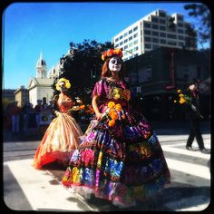 (iPhone image using Hipstamatic left-right ) Members of You Art San Jose Laura San Pablo, Brenda Galvan, center, John Lundin participate in the traditional Day of the Dead procession from City View Plaza to San Jose State in downtown San Jose, Calif. on Sunday, Oct. 15, 2015. (Josie Lepe/ Bay Area News Group)