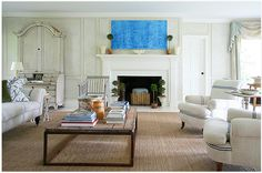 clean and comfy room designed by Carrier and Company.  I'm LOVING those chairs and sofa with the blue stripes.